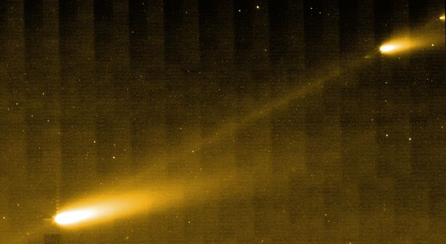 NASA's Spitzer Space Telescope shows three of the many fragments making up Comet 73P/Schwassman-Wachmann 3. The picture also provides the best look yet at the crumbling comet's trail of debris.