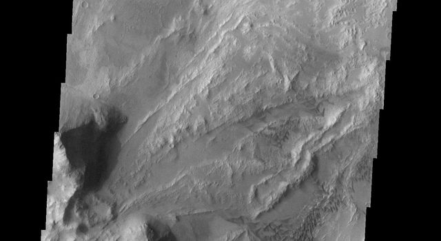 The dunes and landslides in this image occur within Coprates Chasma on Mars as seen by NASA's 2001 Mars Odyssey spacecraft.