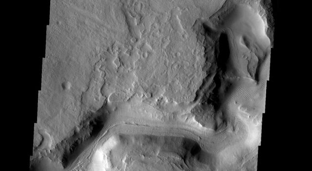 This image shows a portion of Auqakuh Vallis on Mars as seen by NASA's 2001 Mars Odyssey spacecraft.