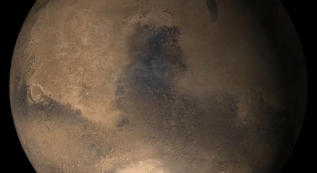 This picture is a composite from NASA's Mars Global Surveyor of daily global images acquired at Ls 53° during a previous Mars year. This month, Mars looks similar, as Ls 53° occurs in mid-May 2006. The picture shows the Syrtis Major face of Mars.