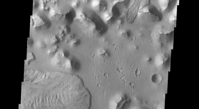 The landslides in this image are located in Aurorae Chaos on Mars as seen by NASA's 2001 Mars Odyssey spacecraft.