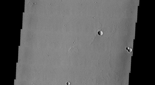 This image from NASA's 2001 Mars Odyssey spacecraft is THEMIS ART IMAGE #62 The unusual erosion around these craters gives the appearance of gears in a machine.
