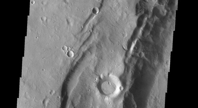 This image is from NASA's 2001 Mars Odyssey. THEMIS ART IMAGE #63 Seattle Seahawk fans may recognize their team emblem in the collapse region around this crater.