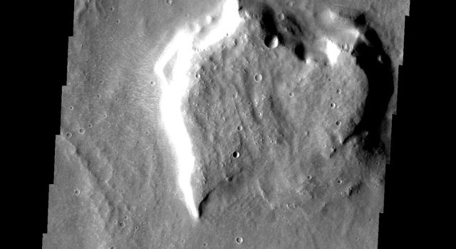 This image from NASA's 2001 Mars Odyssey spacecraft is THEMIS ART IMAGE #65 This martian mesa reminds us of a heart.