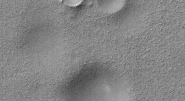NASA's Mars Global Surveyor shows a group of impact craters in Aonia Planum, Mars. Remarkably, two of the craters are approximately equal in size, however, they clearly differ in age.