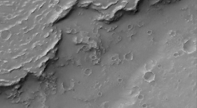 NASA's Mars Global Surveyor shows the sinuous margin of a dust-covered, ridged lava flow in southern Daedalia Planum, Mars.