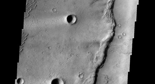 These dunes occur in the Syrtis Major volcanic complex, near Meroe Patera on Mars as seen by NASA's 2001 Mars Odyssey spacecraft.
