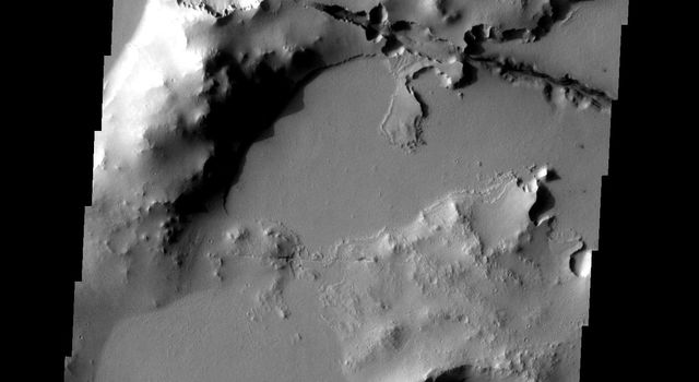 One of the Cerberus Fossae fractures cuts through the plains and highlands on Mars in this image from NASA's 2001 Mars Odyssey spacecraft.