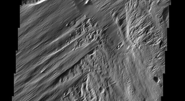 The action of the wind is sculpting and removing material in this area on Mars. The older surface below is being re-exposed, a process called exhumation. This image is from NASA's 2001 Mars Odyssey.
