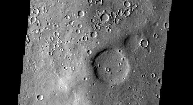 This image from NASA's 2001 Mars Odyssey shows the region of Terra Sabaea on Mars containing areas with high densities of small craters.