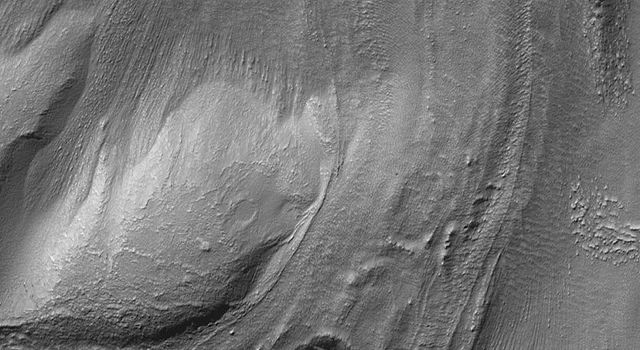 This image from NASA's Mars Global Surveyor shows a flow or landslide feature on a hillslope facing north (toward top/upper right) that is buried on both ends.