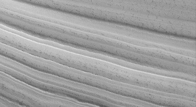 NASA's Mars Global Surveyor shows an unconformity in an exposure of the martian north polar layered material, at which older layers were cut-off and eroded before a new suite of layers was deposited above them.
