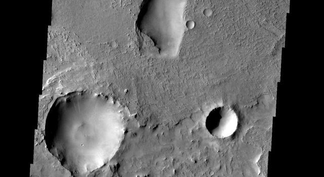 These odd shaped pits occur on the floor of a large crater in Terra Sabaea on Mars as seen by NASA's Mars Odyssey spacecraft.