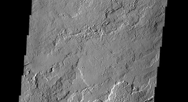 This image shows a small portion of the extensive Tharsis Volcanic Field. Several different surface textures are present on Mars as seen by NASA's Mars Odyssey spacecraft.