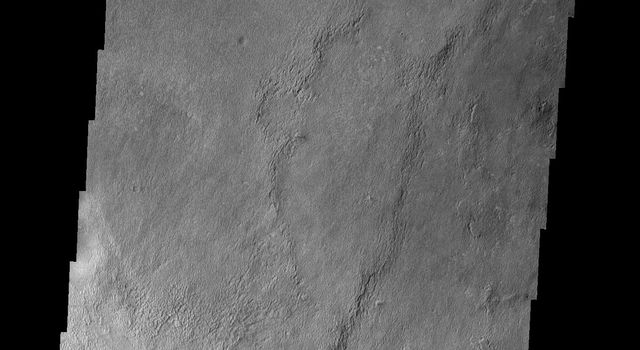 This image shows a small part of Meridiani Planum, the site of the Opportunity Rover on Mars as seen by NASA's Mars Odyssey spacecraft.