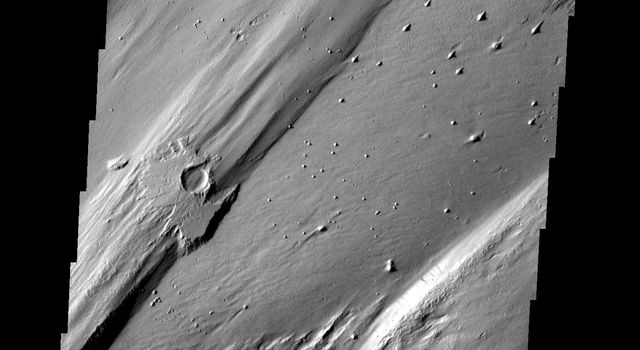 Only a portion of the ejecta remains around this crater. Wind action is creating yardangs and stripping off the surface materials in this region on Mars as seen by NASA's Mars Odyssey spacecraft.