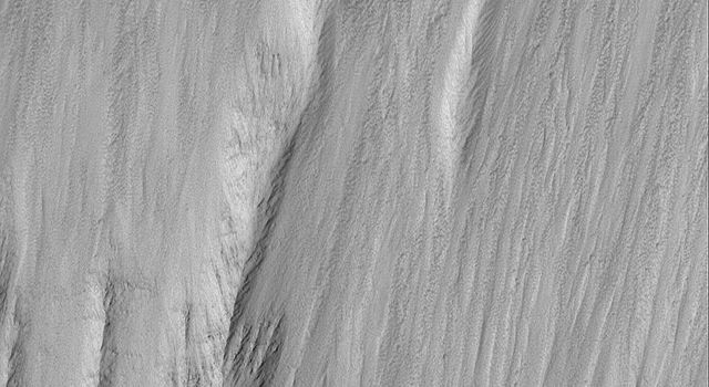 This image from NASA's Mars Global Surveyor shows a landslide that occurred off of a steep slope in Tithonium Chasma, part of the vast Valles Marineris trough system.