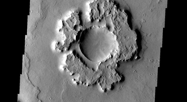 Only the most resistant portions of this crater's ejecta remain on Mars as seen by NASA's Mars Odyssey spacecraft.