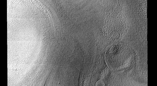 Layers of ice are easily seen in this image of the margin of the South Polar cap on Mars as seen by NASA's Mars Odyssey spacecraft.