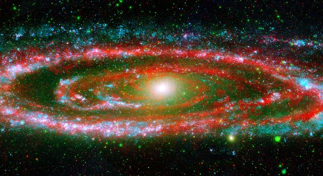 The many 'personalities' of our great galactic neighbor, the Andromeda galaxy, are exposed in this new composite image from NASA's Galaxy Evolution Explorer and Spitzer Space Telescope.