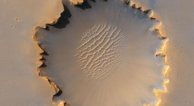 This image from the HiRISE instrument on NASA's Mars Reconnaissance Orbiter shows 'Victoria crater,' an impact crater at Meridiani Planum, near the equator of Mars.