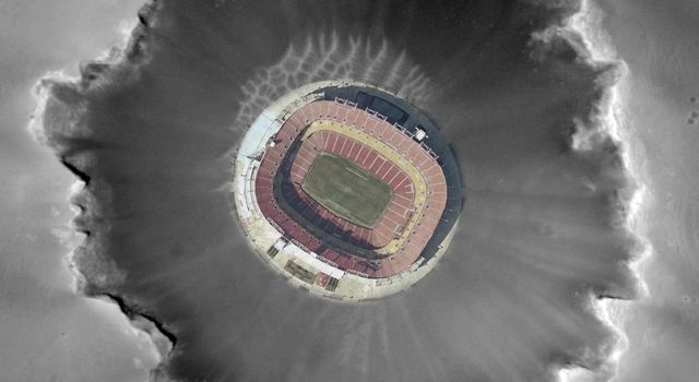 This photo composite shows an aerial view of FedEx Field in Landover, Md., home of the Washington Redskins, superimposed on Mars' Victoria Crater to give a sense of the crater's scale.