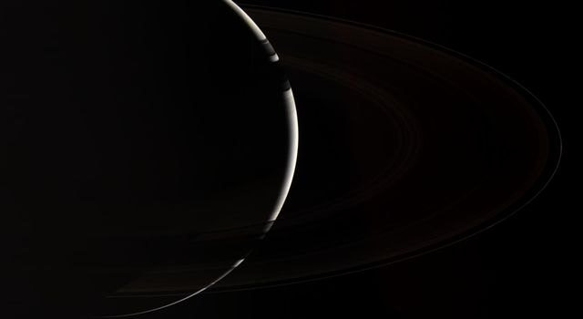 Only NASA's Cassini spacecraft could provide this enchanting, natural color view of crescent Saturn, which gazes down onto the unlit side of the planet's spectacular rings.