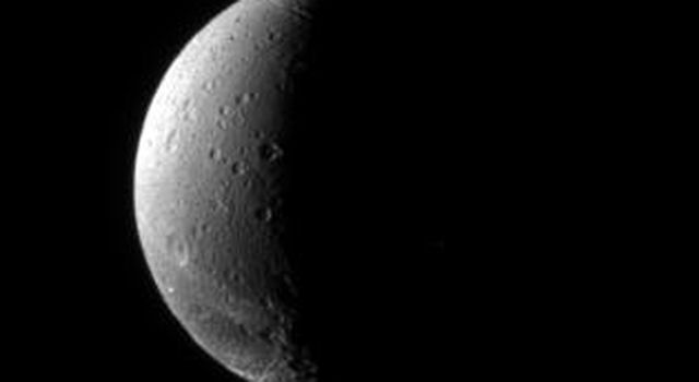 The fractured terrain so distinctive to Dione curves away toward the south in this view, which looks down at the moon's northern hemisphere. This image was captured by NASA's Cassini spacecraft on Nov. 22, 2006.
