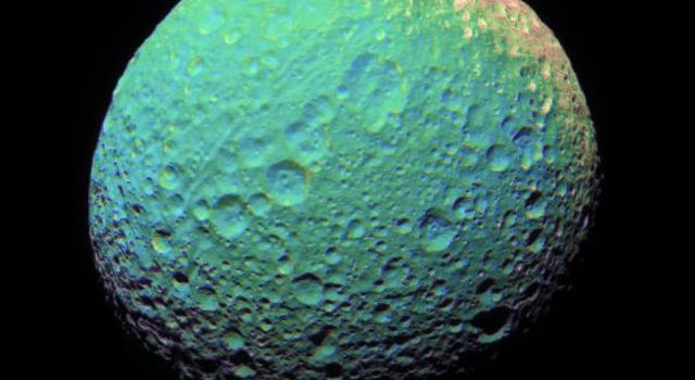 This extreme false-color view of Mimas shows color variation across the moon's surface. This image was captured by NASA's Cassini spacecraft.