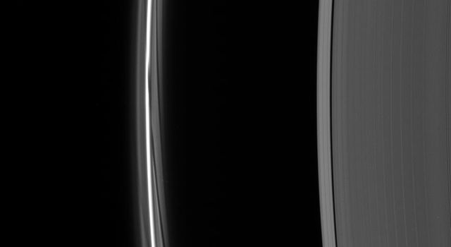 A close-up of the F ring shows dark gores in its interior faint ringlets following the passage of Prometheus. Each gore represents a single interaction of the moon with the F ring material as seen by NASA's Cassini spacecraft.
