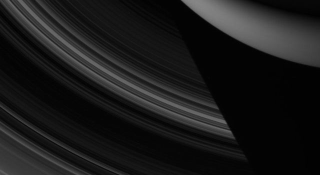 Saturn's entire main ring system spreads out below NASA's Cassini spacecraft in this night side view, which shows the rings disappearing into the planet's shadow.