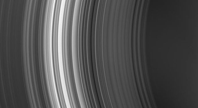 NASA's Cassini spacecraft looks toward the innermost region of Saturn's rings, capturing (from right to left) the C and B rings. The dark, inner edge of the Cassini Division is just visible in the lower left corner.