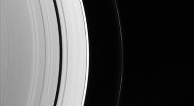 Three of the small worlds that hug the outer edges of Saturn's immense ring system are captured in portrait from NASA's Cassini spacecraft.