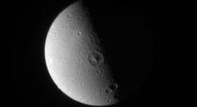 Saturn's Dione's leading hemisphere appears relatively smooth and placid here, compared to the fractured landscape on its trailing hemisphere in this image taken by NASA's Cassini spacecraft on Jan. 19, 2007.