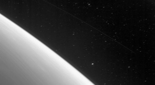 Stars trail across the background during this exposure, timed to capture the faint light from Saturn's D ring features as seen by NASA's Cassini spacecraft.