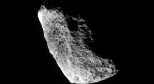 Chaotically tumbling and seriously eroded by impacts, Hyperion is one of Saturn's more unusual satellites in this image from NASA's Cassini spacecraft .