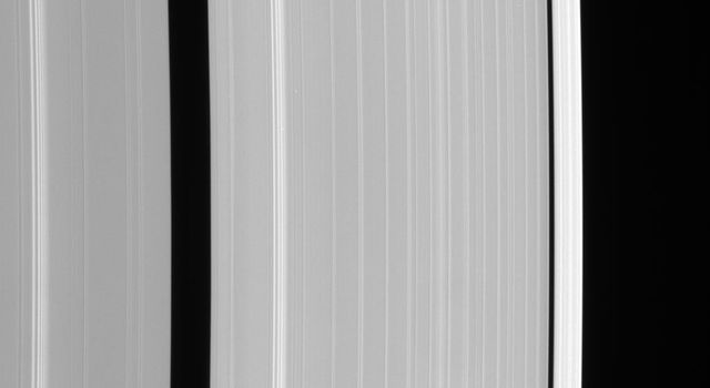 This view from NASA's Cassini spacecraft shows details of Saturn's outer A ring, including the Encke and Keeler gaps. The A ring brightens substantially outside the Keeler Gap.