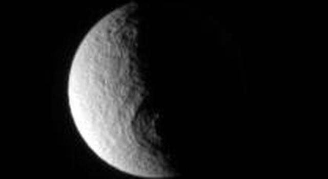 This image from NASA's Cassini spacecraft is of the Odysseus impact basin which lies between night and day on Saturn's moon Tethys.