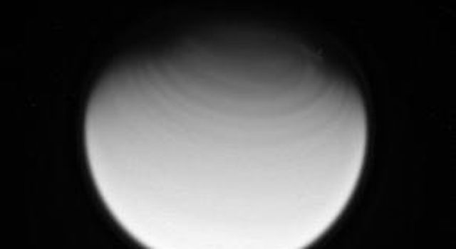 Titan's fast-rotating atmosphere creates circumpolar bands in the north as seen in this image from NASA's Cassini spacecraft taken on March 26, 2007.