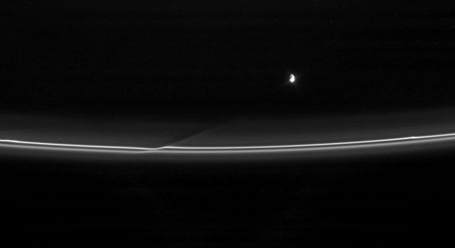 Prometheus pulls away from an encounter with Saturn's F ring, leaving behind a reminder of its passage. This image was taken in visible light with NASA's Cassini spacecraft's narrow-angle camera on April 18, 2007.