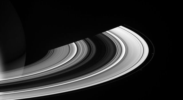 Saturn's brilliant rings are accompanied here by a pack of small moons, Mimas, Janus, Pandora, and Prometheus, as seen by NASA's Cassini spacecraft on April 29, 2007.
