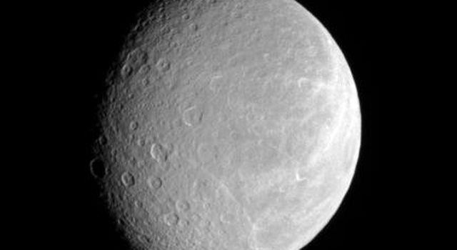 After nearly three years at Saturn, NASA's Cassini spacecraft continues to observe the planet's retinue of icy moons. Rhea's cratered face attests to its great age, while its bright wisps hint at tectonic activity in the past