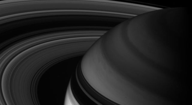 NASA's Cassini spacecraft looks toward northern latitudes on Saturn and out across the ringplane. This infrared view probes clouds beneath the hazes that obscure the planet's depths in natural color views