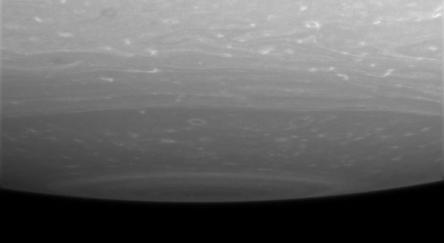 Storms ringed by bright clouds swirl near the south pole of Saturn. This lateral view from NASA's Cassini spacecraft captures the bull's-eye pattern that surrounds the pole, where a monstrous, hurricane-like storm resides.
