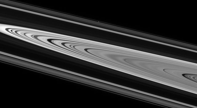 Saturn's enchanting rings display crisply defined edges and strong contrast on their unilluminated side. This image was taken in visible light with NASA's Cassini spacecraft's narrow-angle camera.