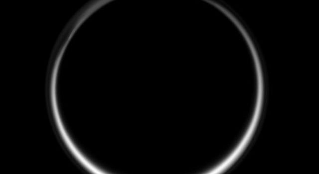 This celestial circle of light is produced by the glow of sunlight scattered through the periphery of Titan's atmosphere as the Sun is occulted by Titan. This image was taken in visible blue light with NASA's Cassini spacecraft's wide-angle camera.