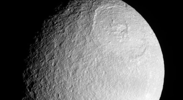 NASA's Cassini spacecraft provides a stunning view of the Odysseus impact basin on Tethys. The enormous basin is 450 kilometers (280 miles) wide.