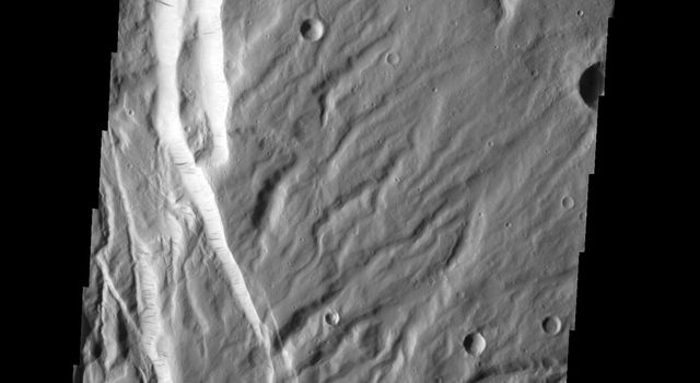 This faulted and eroded surface is part of Acheron Fossae on Mars as seen by NASA's 2001 Mars Odyssey spacecraft.