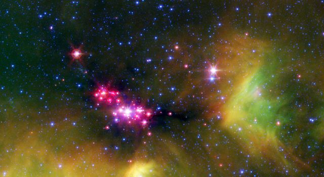 Infant stars are glowing gloriously in this image of the Serpens star-forming region, captured by NASA's Spitzer Space Telescope.