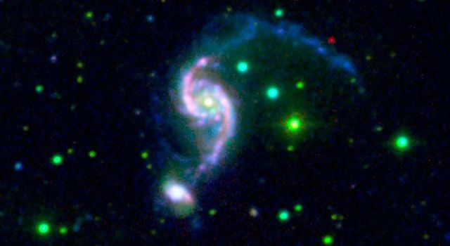 NASA's Galaxy Evolution Explorer and Spitzer Space Telescope combined to show a pair of interacting galaxies might be experiencing the galactic equivalent of a mid-life crisis.